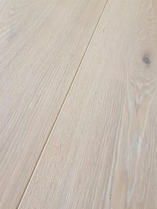 Whitewashed flooring, limed oak tints, brushed with oil finish