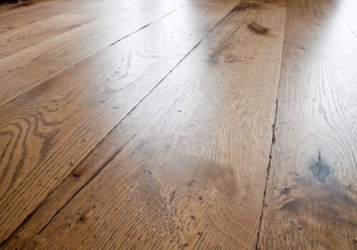 Reclaimed timber flooring effect. Tumbled, coloured and oiled Oak with an antique wood look.