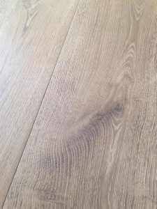 Light grey Oak flooring, fumed, brushed, coloured and oiled to create a contemporary plank floor.