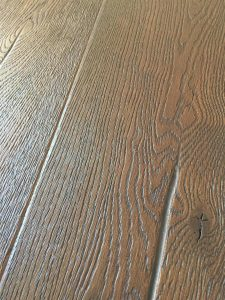 Dark wood oak flooring, deeply brushed and textured to create a beautiful antiqued floor.