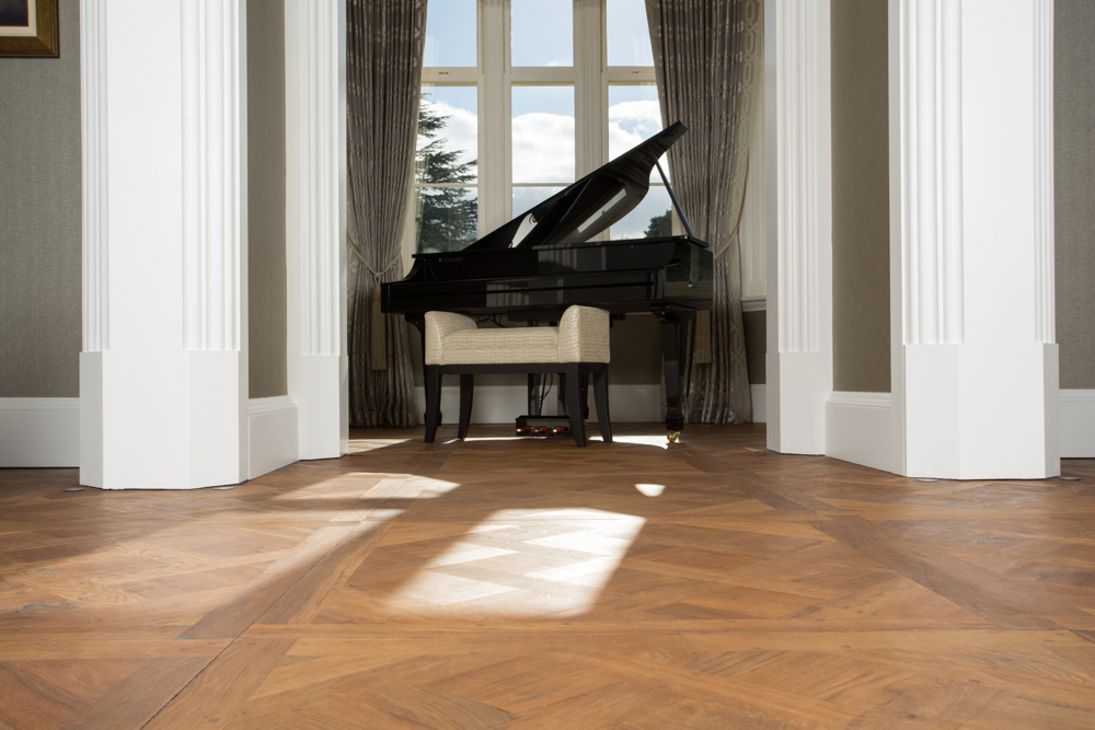 Oak Versailles panels parquet flooring with piano